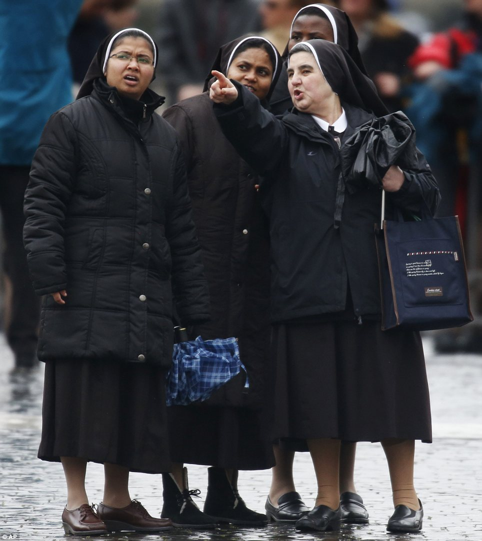 Sightseeing: A group of nuns in the Vatican's main square looking towards the Sistine Chapel