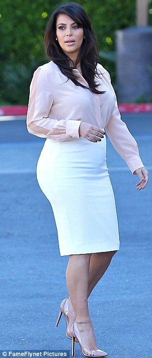 Stylish Mother To Be Kim Wore A White Pencil Skirt And Peach Shirt