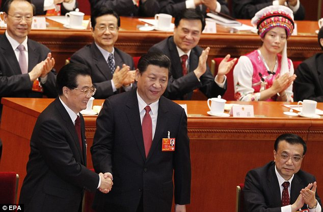 Congratulations: China's new president Xi Jinping, centre, shakes hand with his predecessor Hu Jintao