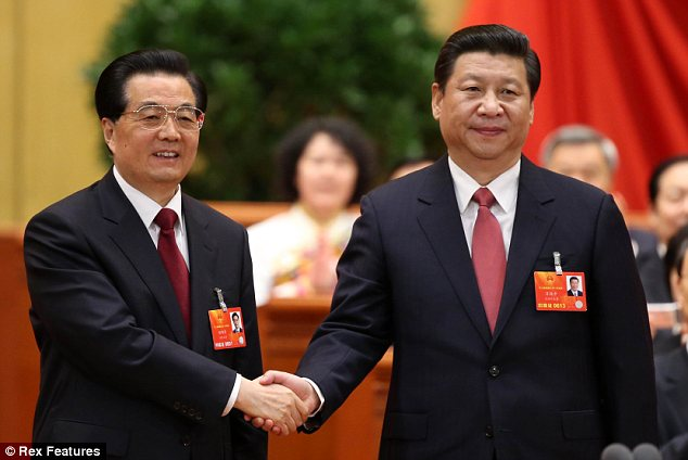 New president: Xi Jinping, right, has taken over as China's top leader from Hu Jintao, left