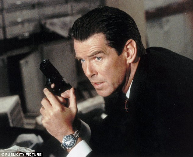 Gadget: Former James Bond Pierce Brosnan displaying an Omega watch worn in one of his hit 007 movies