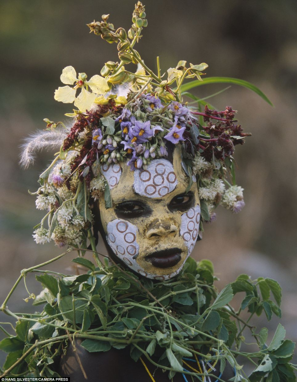 Celebration: Photographer Hans Silvestre described the paint and head dresses worn by his subjects as a 'kind of coquetry, seduction, pride and celebration'