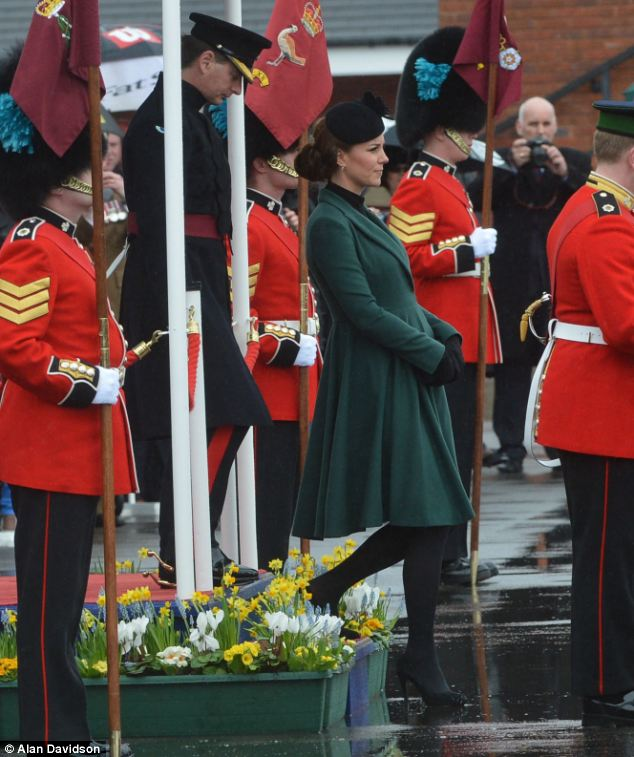 Baby bump: The Duchess of Cambridge's bump was visible under her green Emma Wickstead dress