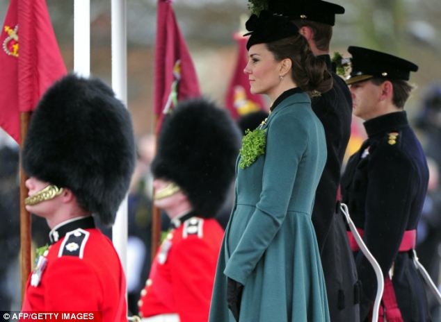 Ceremony: The Duke and Duchess of Cambridge braved the rain and cold during the visit