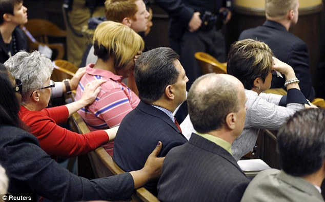 Family members console each other as Judge Thomas Lipps (not shown) delivers the verdicts in the trial of Ma'lik Richmond, 16 and Trent Mays, 17, in juvenile court in Steubenville, Ohio, March 17, 2013