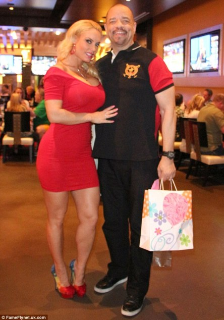 The happy couple: Ice-T and Coco put the rumours of marriage trouble behind them as they posed for a photograph