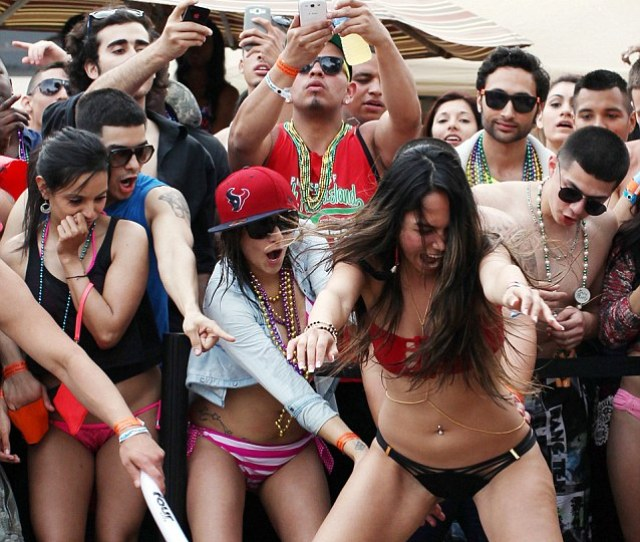 Crowd Members Cheer As A Participant Performs In A Dance Contest At The Isla Grand Hotel