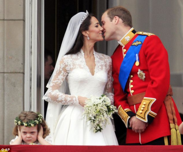 Prince William kisses his wife Kate Middleton, Duchess of Cambridge on the balcony of Buckingham Palace after the Royal Wedding in London