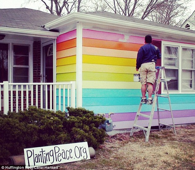 Painting with pride: Aaron Jackson enlisted the help of a team of volunteers who gave the home a complete makeover in a matter of hours