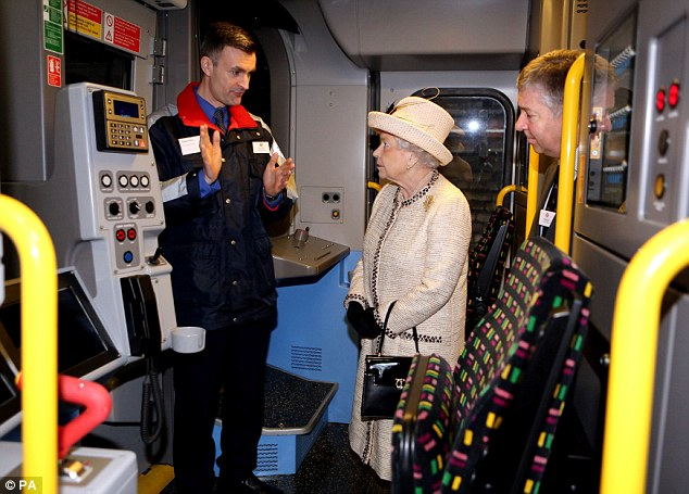 Technology: Tube staff talk to Queen Elizabeth about a new S7 train unveiled at Baker Street station today