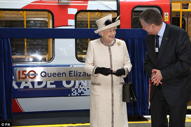 Honour: Queen Elizabeth stands next to plague with her named on it on platform 1 of the Northern-bound Metropolitan Line