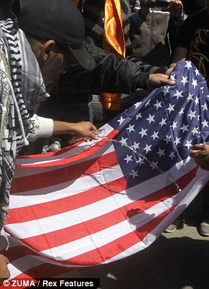 In pieces: Jerusalem is covered in American flags for Obama's arrival but some of them were clearly used in different ways that initially intended