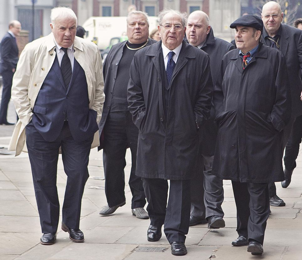 Well-known associate of the Kray brothers Freddy Foreman (centre) leads a group of mourners to the funeral