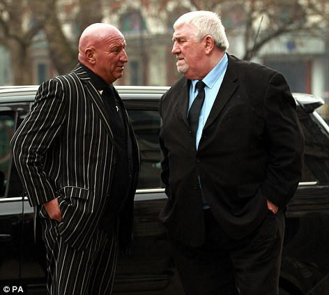 Dave Cortney (left) and Chris Lambriano attend the funeral of Bruce Reynolds, the mastermind behind the Great Train Robbery of 1963 at St Bartholomew The Great Church in Smithfield, London