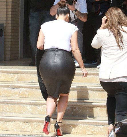 Not dressing for comfort: Trussed up Kim can't have felt at ease