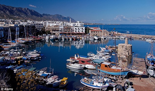 You can buy anything in Cyprus, the saying goes, from a villa on the beach to the entire country. The Russians started with the first and are on the way to the second (pictured Kyrenia Old Port, Northern Cyprus)