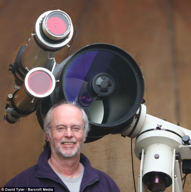 David Tyler poses with the 5-inch refracting telescope equipped with a hydrogen alpha filter used to capture images of the sun in High Wycombe