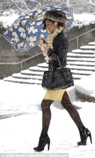 A woman walking in the snow in Birmingham city centre