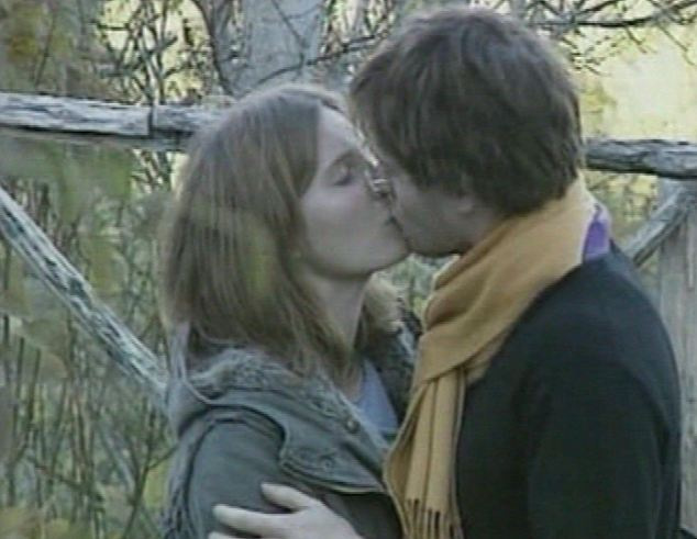 Amanda Knox and Raffaele Sollecito were seen kissing in the wake of the murder