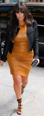 Hell for leather: Kim Kardashian wore a skin tight frock as she changed for the third time in New York on Tuesday