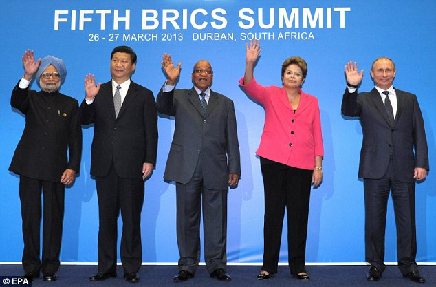 Group: All five BRICS leaders, including Manmohan Singh of India, pose for a picture together today