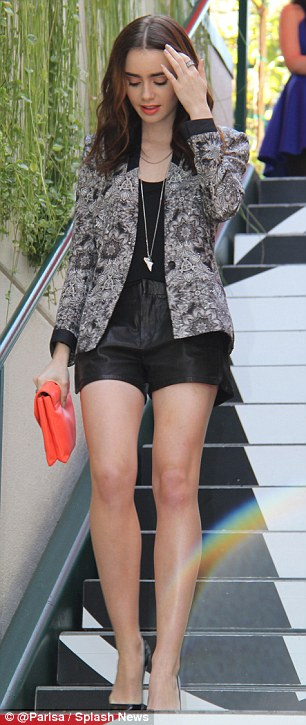 Lily Collins Shows Off Her Tiny Leather Shorts Daily
