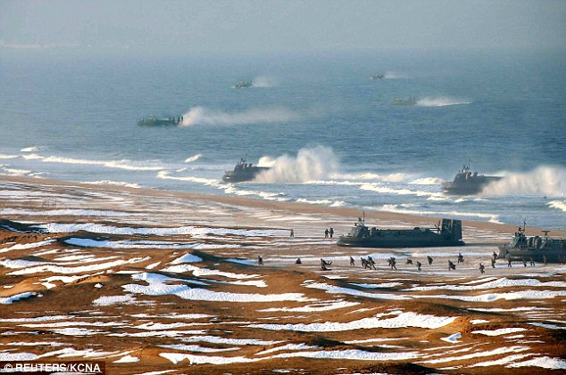 Suspicious: North Korea's state-issued photograph purported to show eight military hovercraft storming a beach, but close inspection suggests some vessels were digitally added