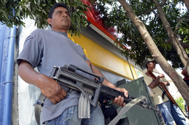 Takeover: A group of around 1,500 armed vigilantes have seized control of Tierra Colorado in Mexico this week