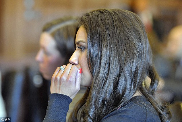 Putting on a show: Dressed to the nines and sporting heavy makeup and bright manicure, Wright quietly answered 'guilty' 20 times when the judge read the counts