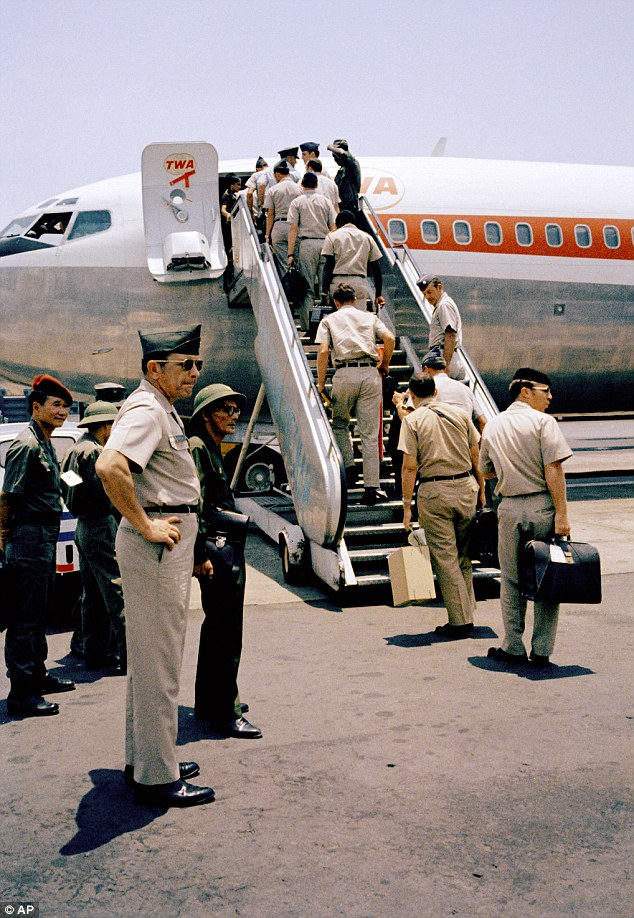 Boarding: In a curious ending to a bizarre conflict, American troops boarded jets under the watchful eyes of North Vietnamese and Viet Cong observers in Saigon