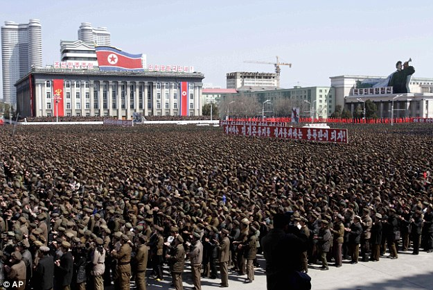 North Koreans gather at a rally at Kim Il Sung Square in downtown Pyongyang, North Korea on Friday, March 28, 2013