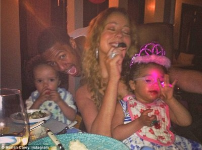 Family bliss: Mariah enjoys a mean with husband Nick Cannon and their twins after arriving at their holiday destination