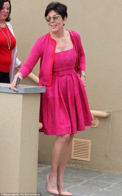 Pop of colour! Kris Jenner went the opposite route of her family and opted for a vibrant pink dress and matching cardigan