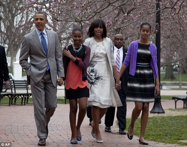 President Barack Obama, daughter Sasha, First Lady Michelle Obama and daughter Malia walk from the White House across Lafayette Park on their way to church at St John's Episcopal Church in Washington, D.C. today