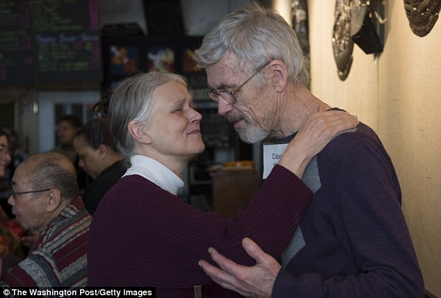 Peace: Hilfiker (right) says he's experiencing a new sense of inner peace and a renewed love for his wife (left) that has vastly enriched his life