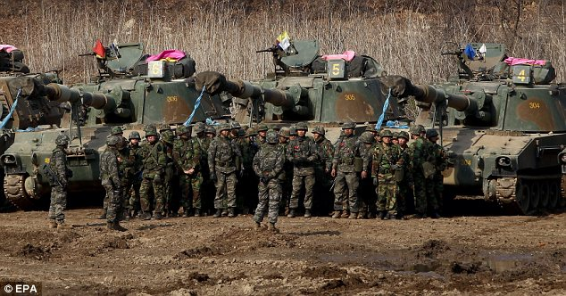 Lining up: South Korean soldiers man the tanks at a drill near the border with neighbouring North Korea