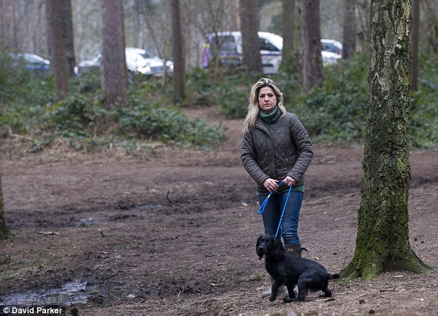Melissa Kite with her dog Cydney at the woods
