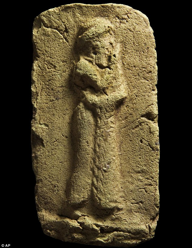 Exquisite: This clay plaque from the site shows a worshipper in a flowing robe approaching a sacred place