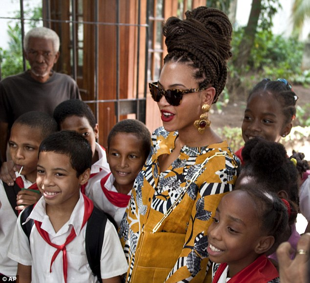 You're my idol: The songstress met with schoolchildren and posed for a photograph with them