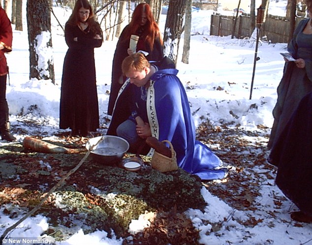 Caped crusader: Halloran, pictured kneeling during a Theodish ceremony, converted to the pagan polytheistic religion from Roman Catholicism in 1989
