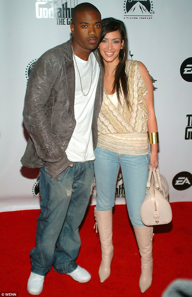 Not letting go: The rapper, pictured with Kim in 2006, lays claim to his ex in the new single, stating, 'she belongs in my bed'