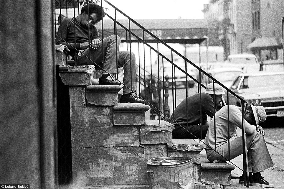 Down time: The economy in New York City sputtered to a halt in the 1970s, leaving tens of thousands without work. These men were seen napping on a stoop on 30th Street in Manhattan's Chelsea neighborhood