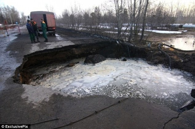 The sinkholes, some large enough to swallow an entire truck, are believed to have opened up as the Russian winter subsides