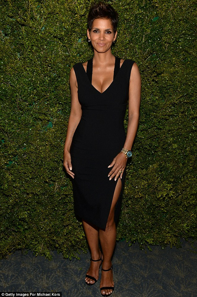 Figure hugging: On Saturday, Halle wore a tight black dress which hugged her new curves to an event at the Pool Room at the Four Seasons Hotel in New York City