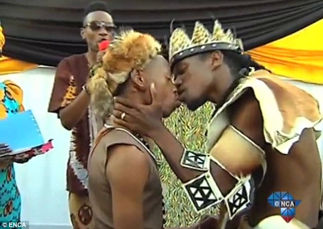 Love: In this still from South African broadcaster ENCA, the couple enjoy their first married kiss