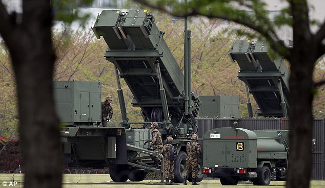 At the ready: Japanese forces set up Patriot anti-missile defence systems in Tokyo today as the threat level over a North Korea missile launch was raised to 'vital'