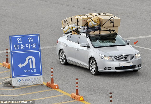 Escape: A car loaded with boxes arrives in South Korea from the Kaesong joint industrial complex