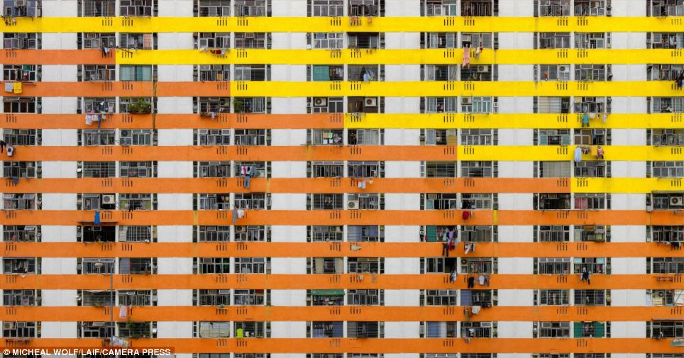 Perspective: This photograph may appear baffling at first glance, but closer inspection reveals it is a shot of dozens of windows and balconies in another Hong Kong apartment block