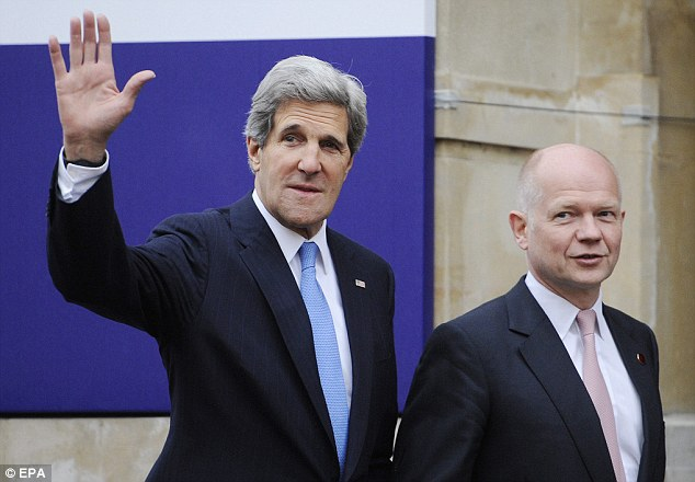 Urgent talks: British Foreign Secretary William Hague (right) walks with U.S. Secretary of State John Kerry ahead of a G8 meeting which will focus on the developing crisis in North Korea