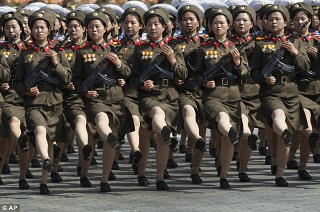 Goose-stepping girls: Propaganda songs have been written to attract more women into the coastal artillery units and women fighters now guard nearly all tunnels and bridges (file picture)